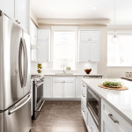 Open plan kitchen with island of Amherst Lane townhomes built by Balandra Homes